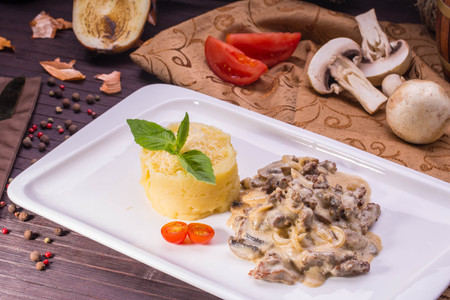 Beef Stroganoff. Juicy veal, stewed with mushrooms and onions in gentle creamy sauce