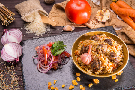 stewing: Pilaf, with meat of a lamb, rice and spices, with carrots and onions Stock Photo