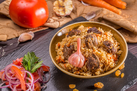 stewing: Rice pilaf with meat of a lamb, with stewed vegetables, onions, carrot and garlic