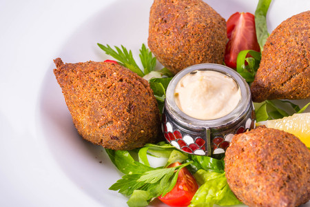 Meatballs, deep fried, from wheat grains with pine nuts and onions Stock Photo