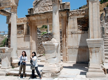 Asian tourist in front of Temple of Hadrian, Ephesus, Turkey,