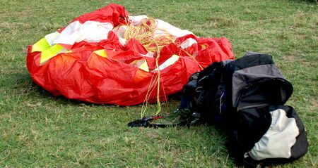 Red paraglider and his empty bag  photo