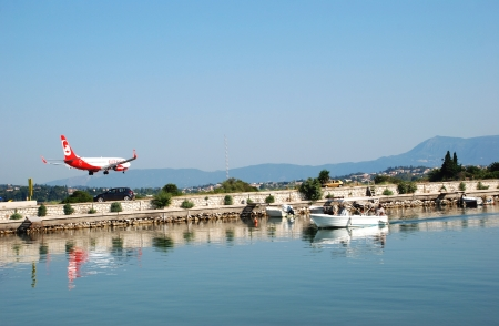 arrives: Plane arrives at the airport in Kerkyra, Corfu Island, Greece