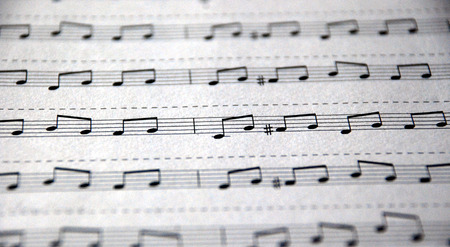 orchestrate: Musical notes written on notational lines