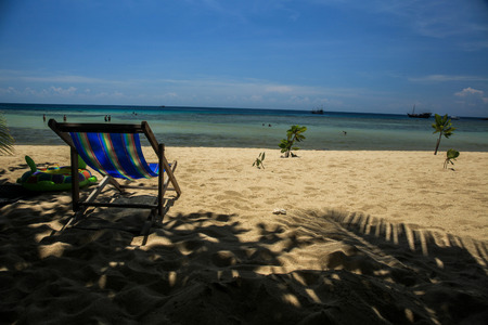 intended: Relaxing beach chair on tropical white sand beach - (Close-up). Its intended to show freedom of lifestyle.
