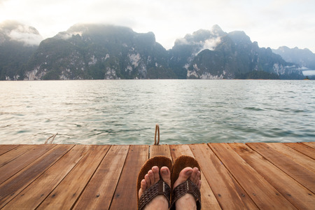 relaxing feet on the smooth flow of river and islands ahead. It represents freedom and relaxation.
