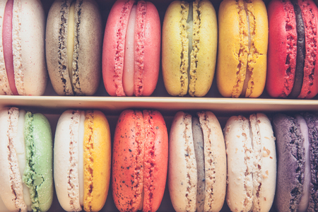stacked up: Stack of colorful macaroons stacked up in the box for background - in vintage tone Stock Photo