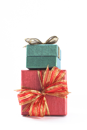 stacked up: Two festive gifts being stacked up in white isolated background