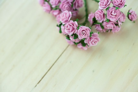 in insert: Light magenta roses in wood isolated background - Can be used to insert festive campaigns Stock Photo