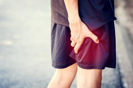 Runner touching painful leg. Athlete runner training accident. Sport running leg sprain.