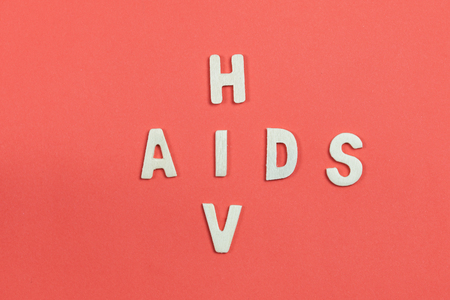 sexually infection: HIV and AIDS Puzzle on Red Blood Background