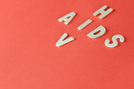 sexually: HIV and AIDS Puzzle on Red Blood Background
