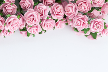 text pink: Light magenta roses in wood isolated background - Can be used to insert festive campaigns Stock Photo