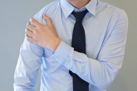 shoulder problem: Man having shoulder pain problem Stock Photo
