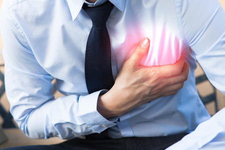 Man in office uniform having heart attack  heart burn Stok Fotoğraf