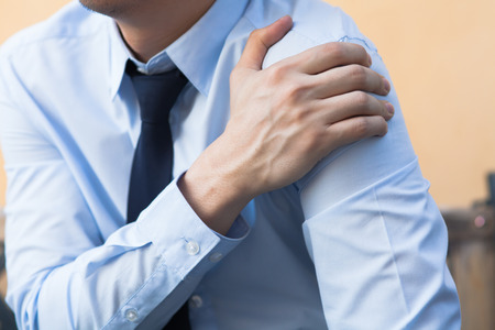 Man having shoulder pain problem Standard-Bild