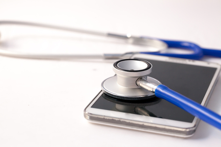 diagnosed: Smartphone being diagnosed by stethoscope - phone repair and check up concept Stock Photo