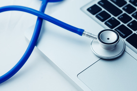 computer virus protection: Stethoscope on laptop - Computer repair and maintenance concept - in dark tone Stock Photo