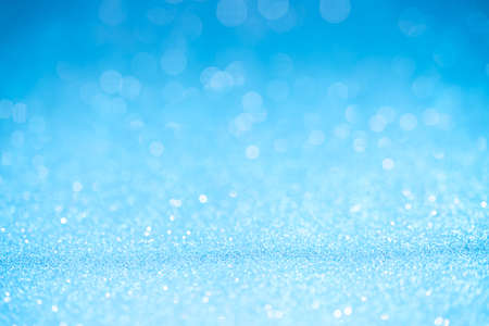 special occasions: Blue glitter surface with blue light bokeh - It can be used for background for special occasions promotion campaign or product display Stock Photo
