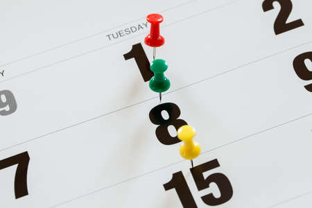 important reminder: Pushpins on calendar, Busy and overworking days. Important date or meeting appointment reminder concept. Stock Photo