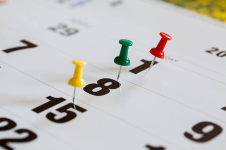 overworking: Pushpins on calendar, Busy and overworking days. Important date or meeting appointment reminder concept. Stock Photo