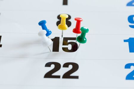 important date: Pushpins on calendar, Busy and overworking days. Important date or meeting appointment reminder concept. Stock Photo