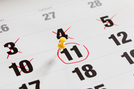 Red circle marked and pin pushed on a calendar and X Mark for counting down. concept for an important day. Stock Photo