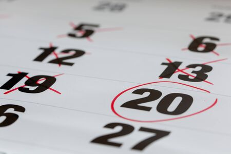 marked down: Red circle marked on a calendar and X Mark for counting down. concept for an important day. Stock Photo