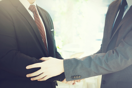 warm welcome: Two businessmen giving warm welcome, trust, teamwork, agreement to each other concept