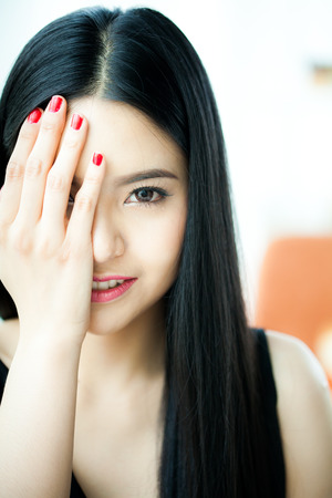 Beautiful Asian woman face in white background - beauty concept