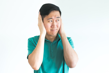 oblivious: Stressed man covering his ears and do not want to hear, noise too loud