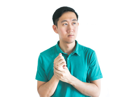stylish man: Serious Asian man thinking about something on isolated white background