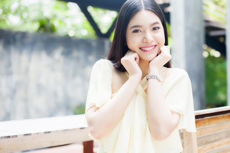 asian women: Beautiful Asian woman smiling in the green park