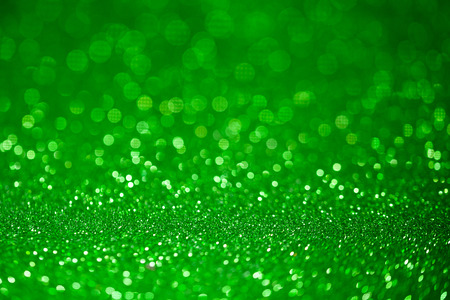 special occasions: Green glitter surface with green light bokeh - It can be used for background for special occasions promotion campaign or product display