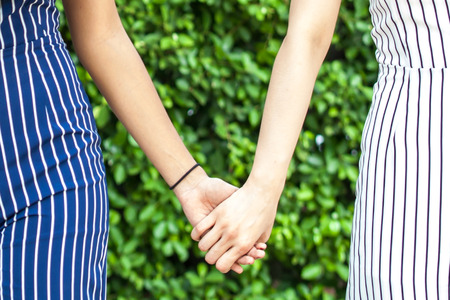best friends girls: Female best friend forever holding hands together - friendship and love concept