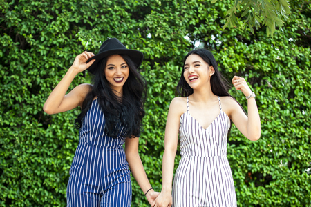 lively: Two happy and lively female best friends having a good time together - friendship and fun time concept