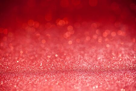 special occasions: Red glitter surface with red light bokeh - It can be used for background for special occasions promotion campaign or product display