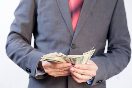 capitalist: Businessman counting bill notes in white isolated background Stock Photo