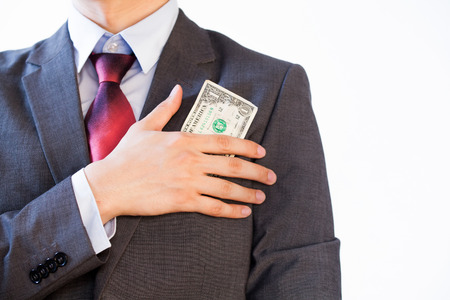 financial official: Business man hiding money in jacket pocket - Corruption and Fraud Concept