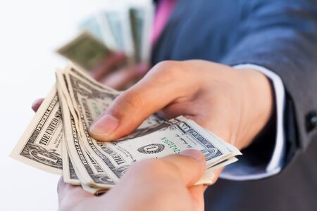 Business man giving bank notes to another person. Corruption and Payment concept Stock Photo