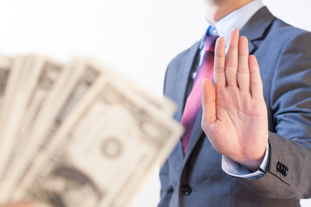 Businessman refuses to receive money - no bribery and corruption concept Stock Photo