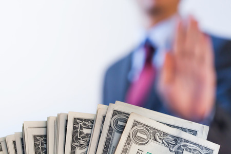 corruption: Businessman refuses to receive money - no bribery and corruption concept Stock Photo
