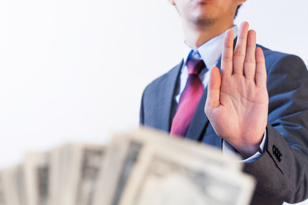venality: Businessman refuses to receive money - no bribery and corruption concept Stock Photo