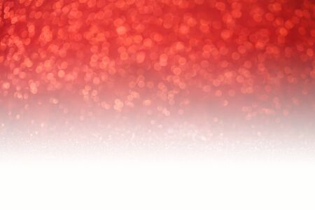 luz roja: Red glitter surface with red light bokeh - It can be used for background for special occasions promotion campaign or product display