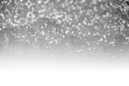 special occasions: Gray glitter surface with gray light bokeh with white copyspace- It can be used for background for special occasions promotion campaign or product display