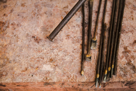 graver: Various kinds of Sculpting Tools laying down on dirty wooden table