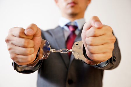 criminal: Business man criminal handcuffed - Business criminal, debt, burden concept