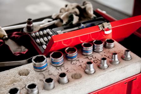 socket wrench: Socket wrench set in car garage.