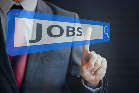 Businessman tapping and searching JOBS on search bar Reklamní fotografie