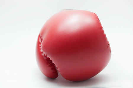 Front-faced boxing glove in white isolated background.